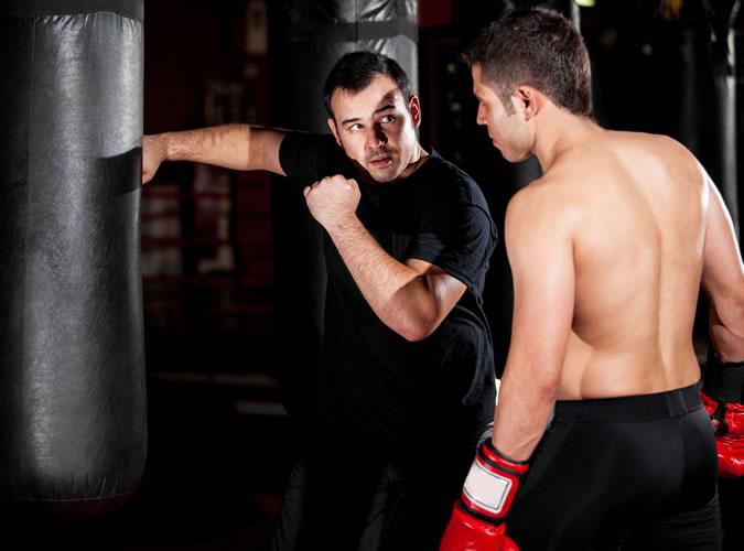 Man teaching boxing