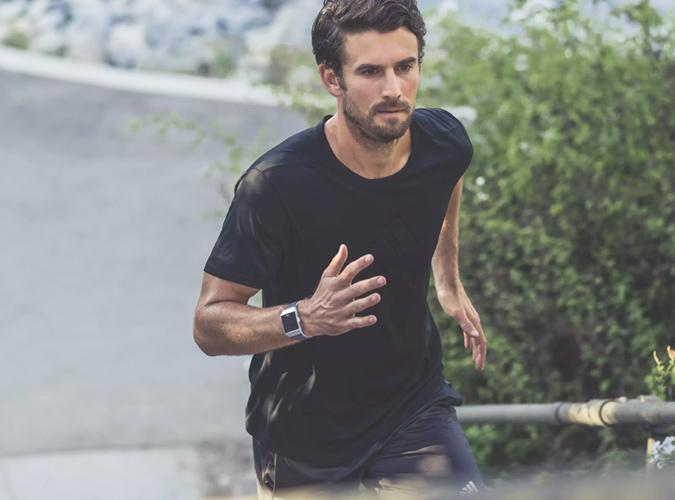 Man Running Wearing A Fitness Watch