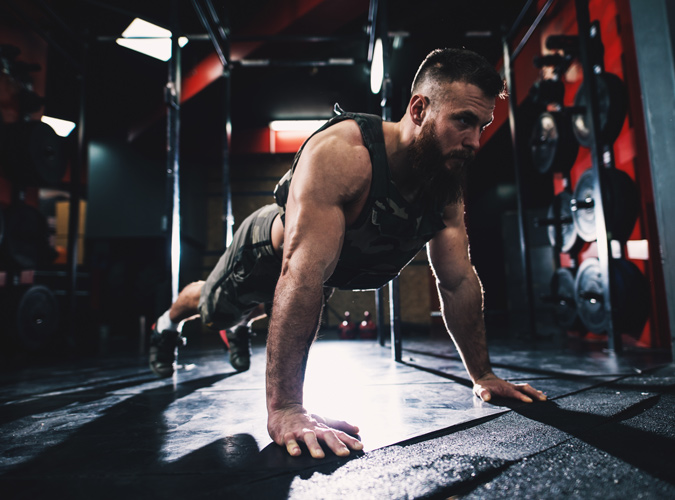 man working out with a weighted vest on